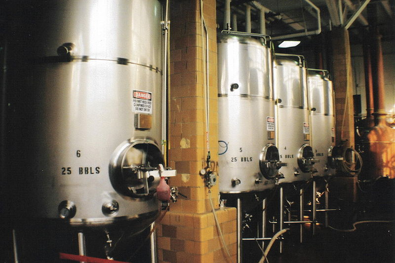 Fermenting tanks with yeast being used to brew beer. Photo by Kafziel